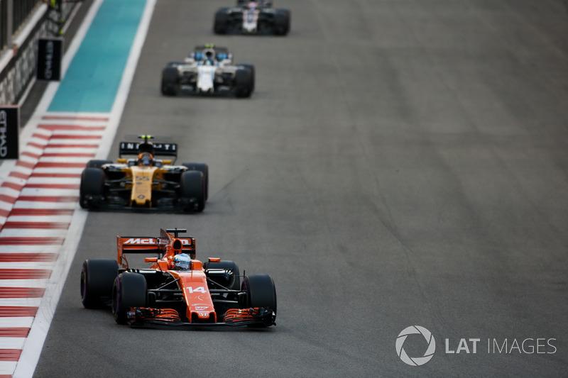 Fernando Alonso, McLaren MCL32, leads Carlos Sainz Jr., Renault F1 Team RS17, and Lance Stroll, Williams FW40