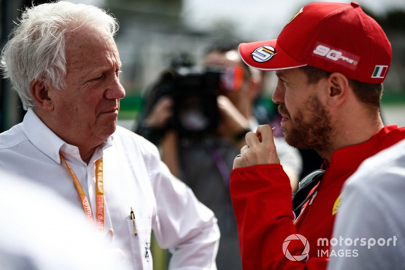Charlie Whiting, Race Director, FIA, with Sebastian Vettel, Ferrari