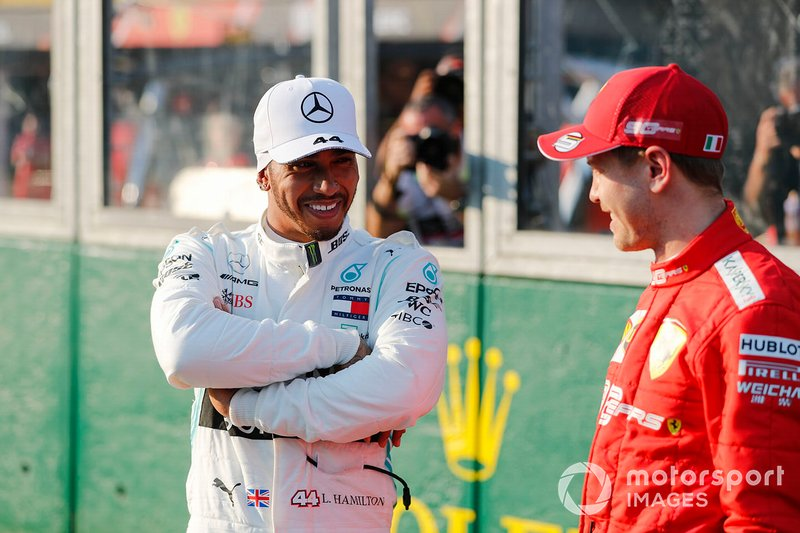 Pole Sitter Lewis Hamilton, Mercedes AMG F1 iand Sebastian Vettel, Ferrari In Parc Ferme