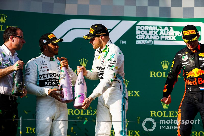 Lewis Hamilton, Mercedes AMG F1, 2nd position, and Valtteri Bottas, Mercedes AMG F1, 1st position, celebrate on the podium with Champagne