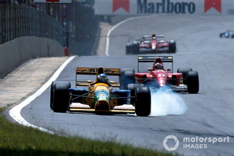 Michael Schumacher, Benetton B191B Ford leads Jean Alesi, Ferrari F92A