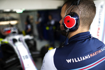 A rememberence poppy sticker on the ear defenders of a Williams mechanic