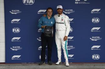 Former F1 racer Felipe Massa presents Lewis Hamilton, Mercedes AMG F1, with the Pirelli Pole Position award