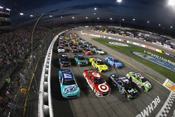 Drivers go four-wide to salute the fans before the start
