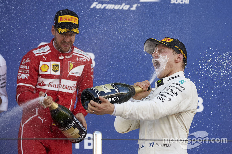 Race winner Valtteri Bottas, Mercedes AMG F1, second place Sebastian Vettel, Ferrari