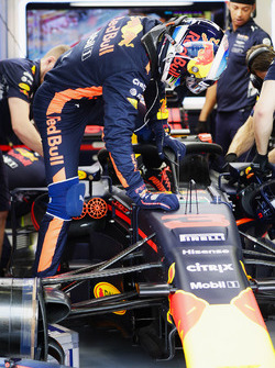 Daniel Ricciardo, Red Bull Racing, climbs in to his cockpit which is fitted, the Halo cockpit protection system