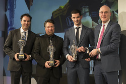 Team Owner Michael Andretti, Co-entrant Bryan Herta and 2016 Indy 500 winner Alexander Rossi with their baby Borg-Warner Trophies and James Verrier of BorgWarner