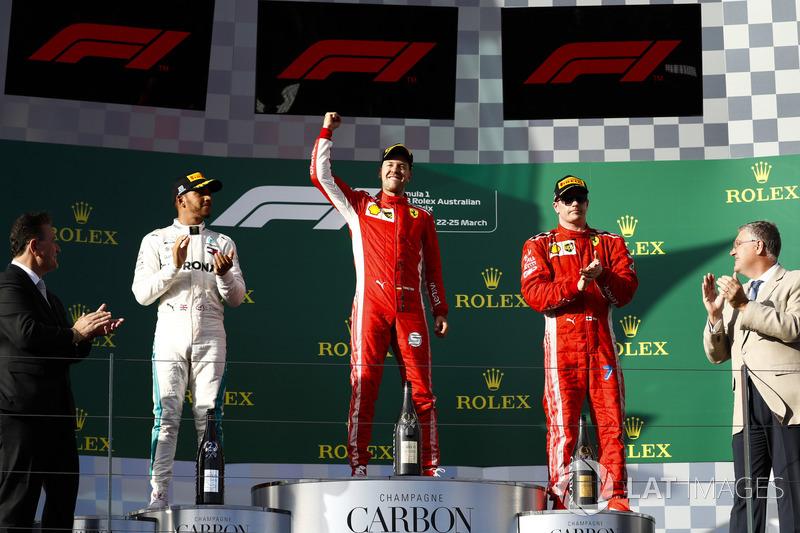 Lewis Hamilton, Mercedes AMG F1, 2nd position, Sebastian Vettel, Ferrari, 1st position, and Kimi Raikkonen, Ferrari, 3rd position, on the podium
