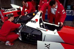 Mechanics work on the car of Ayrton Senna, McLaren Ford MP4/8