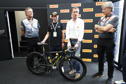 Mario Isola, Racing Manager, Pirelli Motorsport, and Pirelli management with Professional Road Cyclist Simon Yates of Michelton-Scott