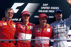 Podium: Paolo Martinelli, Ferrari Engine Director, second place Michael Schumacher, Ferrari, Race winner Rubens Barrichello, Ferrari, third place David Coulthard, McLaren
