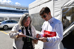 Charles Leclerc, Alfa Romeo Sauber F1 Team signs autographs for his fans