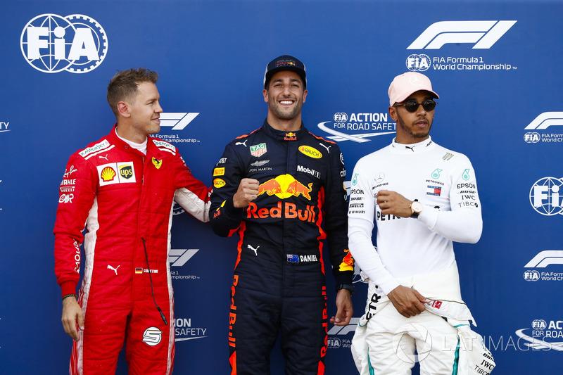 Daniel Ricciardo, Red Bull Racing, celebrates pole position between Sebastian Vettel, Ferrari, and Lewis Hamilton, Mercedes AMG F1