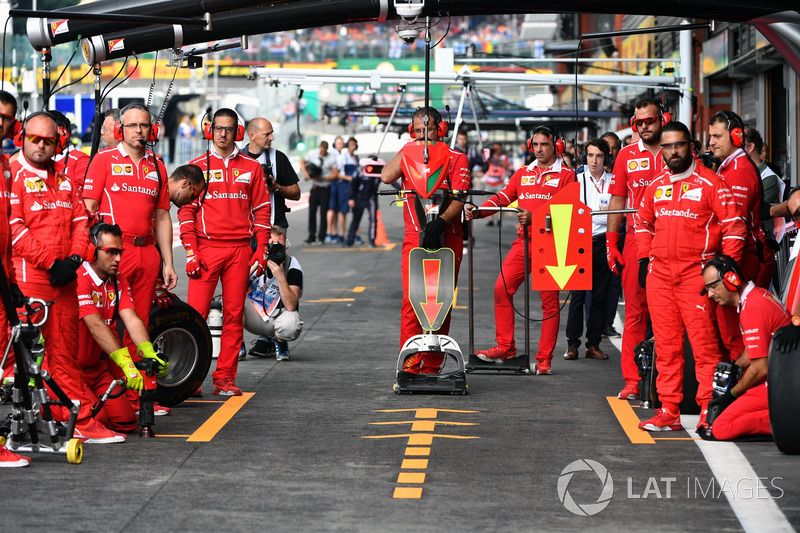 Ferrari mechanics await a pit stop
