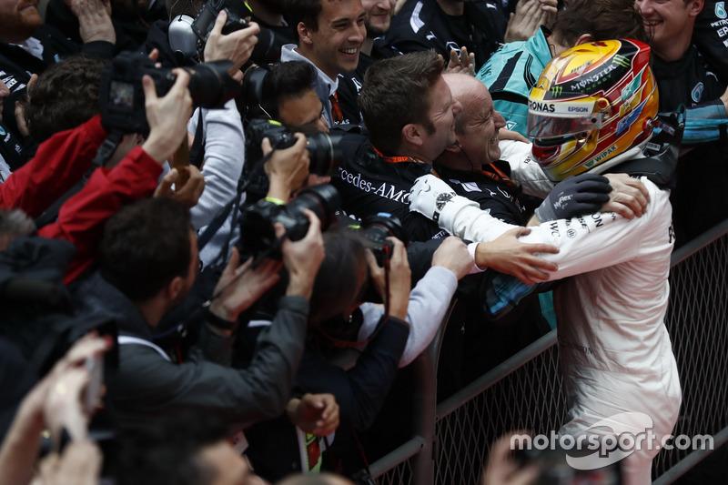 Lewis Hamilton, Mercedes AMG, celebrates in parc ferme with his team