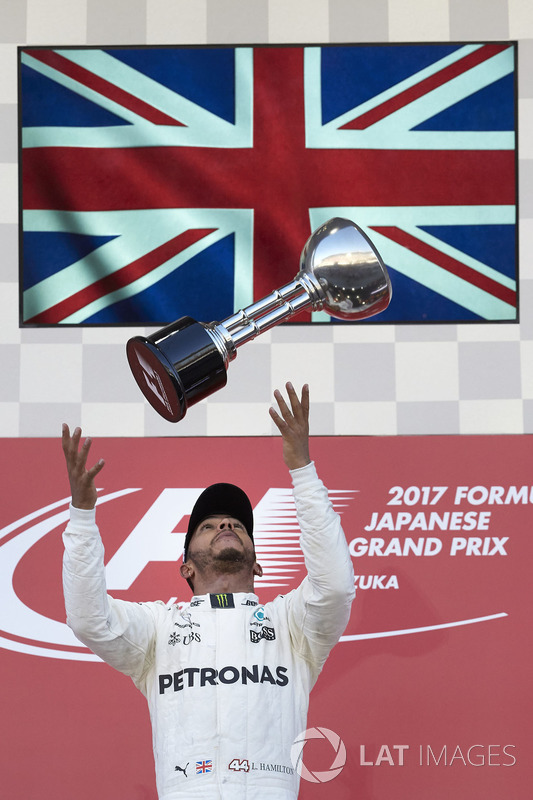 Race winner Lewis Hamilton, Mercedes AMG F1, tosses his trophy in the air in celebration
