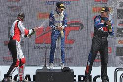 GT Cup podium: race winner Alec Udell, second place Sloan Urry, third place Corey Fergus