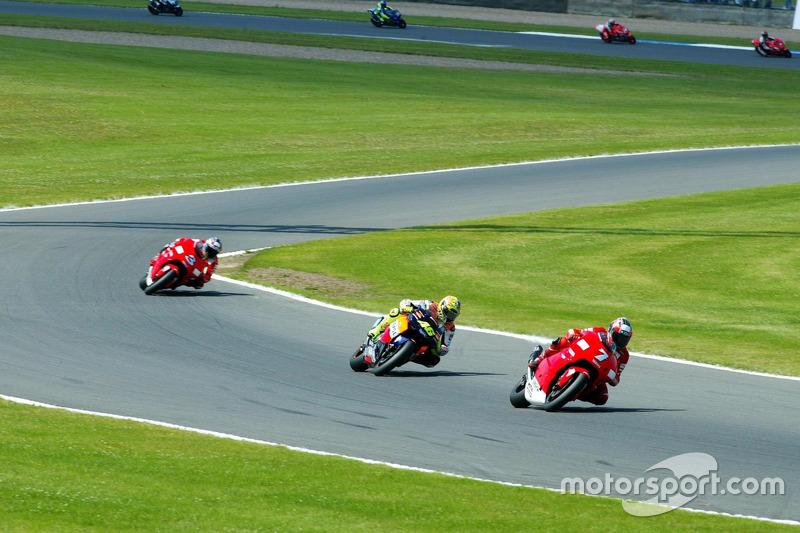 Carlos Checa, Yamaha Team; Valentino Rossi, Honda Team; Max Biaggi, Yamaha Team