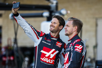 Romain Grosjean, Haas F1 Team, takes a photo with Kevin Magnussen, Haas F1 Team