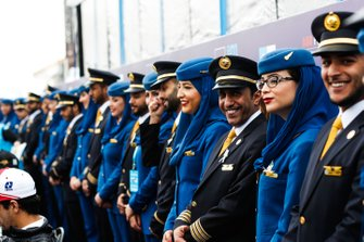 Saudia Airline representatives standing behind the drivers
