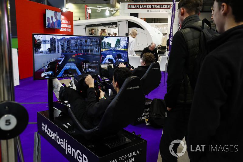 Visitors race on simulators