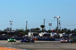 #2 Tequila Patron ESM Nissan DPi, P: Scott Sharp, Ryan Dalziel, Olivier Pla slides wide in turn 1 at the start of the race