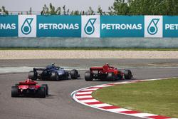 Valtteri Bottas, Mercedes AMG F1 W09, passes Kimi Raikkonen, Ferrari SF71H, for the lead of the race. Sebastian Vettel, Ferrari SF71H, follows