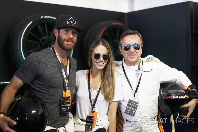 Pirelli Hot Laps passengers including Model Xenia Deli and Chef Daniel Boulud
