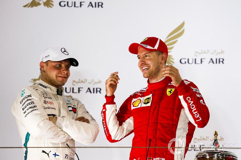 Valtteri Bottas, Mercedes AMG F1, 2nd position, and Sebastian Vettel, Ferrari, 1st position, talk on the podium