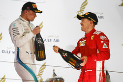 Valtteri Bottas, Mercedes AMG F1, 2nd position, and Sebastian Vettel, Ferrari, 1st position, celebrate with Waard, a non alcoholic Champagne substitute, on the podium
