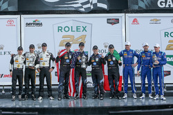 Podium: race winners Ricky Taylor, Jordan Taylor, Max Angelelli, Jeff Gordon, Wayne Taylor Racing, second place Joao Barbosa, Christian Fittipaldi, Filipe Albuquerque, Action Express Racing, third place Marc Goossens, Renger van der Zande, René Rast, VisitFlorida.com Racing
