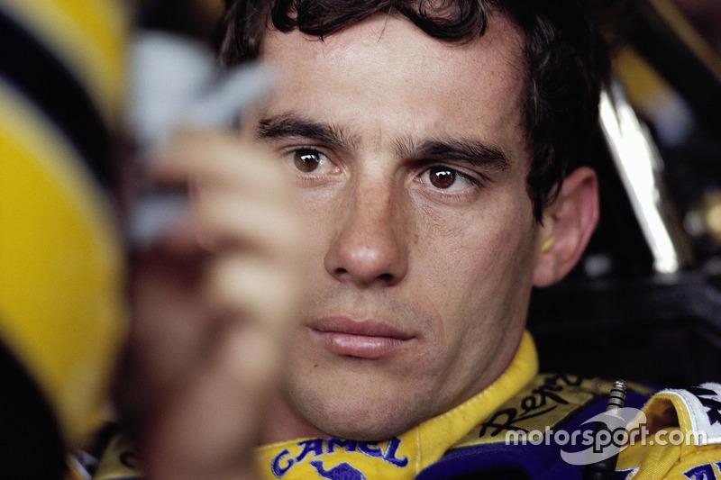 Ayrton Senna straps in to his Lotus cockpit
