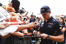 Max Verstappen, Red Bull, signs autographs for fans