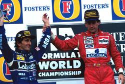 Podium: Race winner Ayrton Senna, McLaren, second place and World Champion Alain Prost, Williams