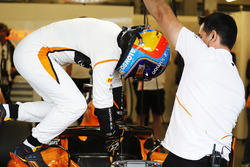 Fernando Alonso, McLaren, climbs out of his car