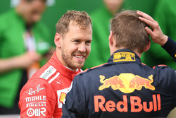 Sebastian Vettel, Ferrari and Max Verstappen, Red Bull Racing in parc ferme