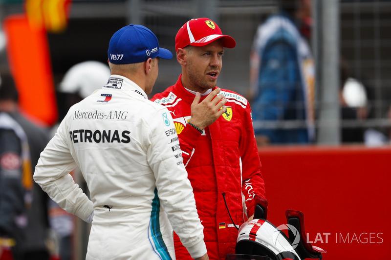 Valtteri Bottas, Mercedes AMG F1, congratulates Sebastian Vettel, Ferrari