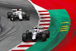 Sergey Sirotkin, Williams FW41, leads Marcus Ericsson, Sauber C37