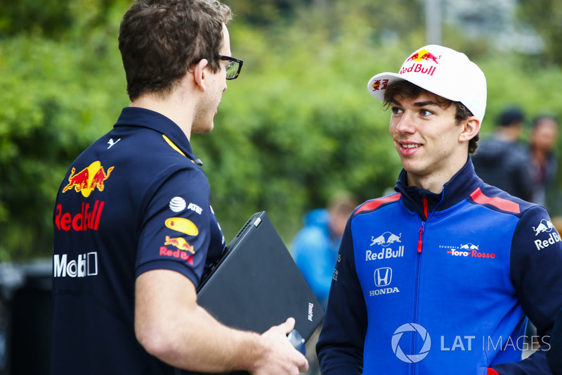 Pierre Gasly, Toro Rosso, talks to a Red Bull team member