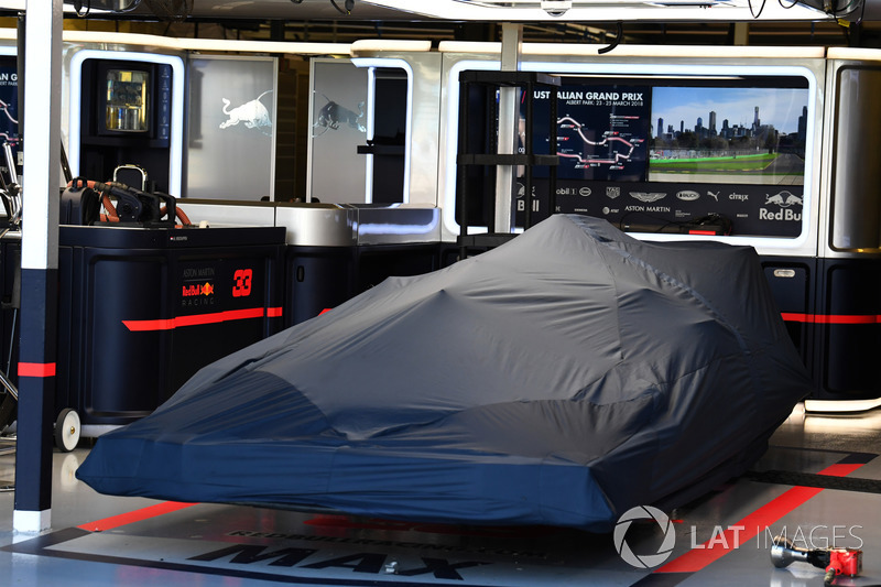 The car of Max Verstappen, Red Bull Racing RB14 under covers in the garage