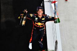 Race winner Daniel Ricciardo, Red Bull Racing celebrates on the podium with the trophy