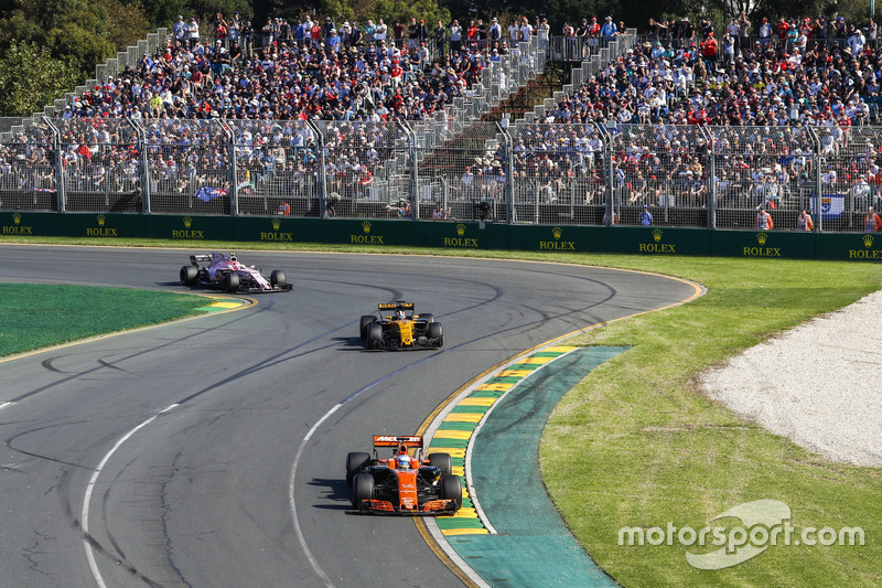 Fernando Alonso, McLaren MCL32, leads Nico Hulkenberg, Renault Sport F1 Team RS17, and Esteban Ocon, Force India VJM10
