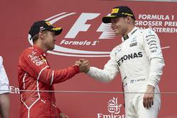 Second place Sebastian Vettel, Ferrari, Race winner Valtteri Bottas, Mercedes AMG F1