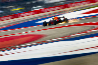 Sparks fly from the rear of Max Verstappen, Red Bull Racing RB14