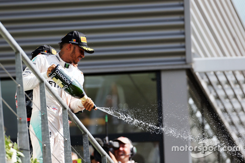 Lewis Hamilton, Mercedes AMG F1 celebrates his third position with the champagne on the podium