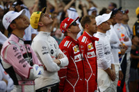 The drivers stand for the national anthem