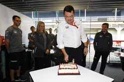 Eric Boullier, Racing Director, McLaren, cuts his birthday cake as Fernando Alonso, McLaren, watches in the background