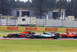 Max Verstappen, Red Bull Racing RB13, leads, Lewis Hamilton, Mercedes AMG F1 W08 and Sebastian Vettel, Ferrari SF70H on the first lap