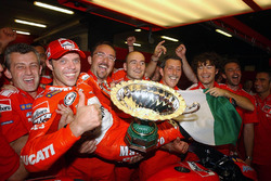 Loris Capirossi celebrating the first Ducati win