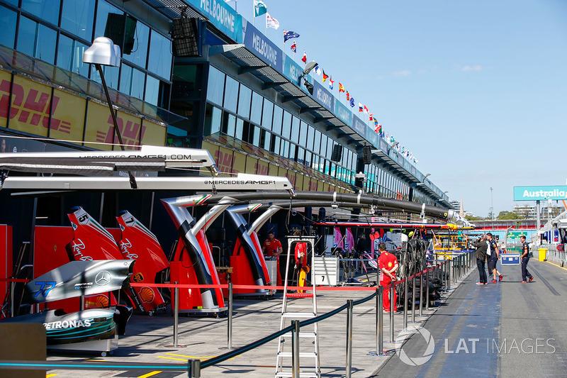 Mercedes AMG F1 and Ferrari garages in the pitman